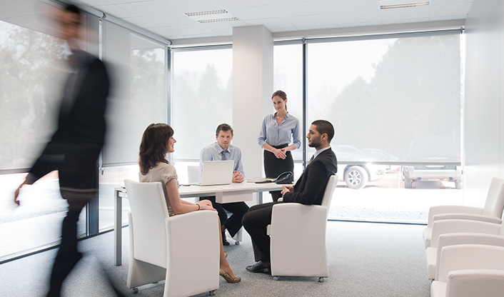 modern office with 5 people in business attire
